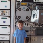 James in a Space Camp Display