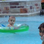 James and Ty in the pool at the apartment in Texas
